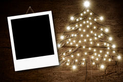 Photo frame Christmas tree wooden background Royalty Free Stock Images