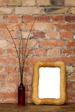 Photo frame and clay bottle with willow catkins Stock Image