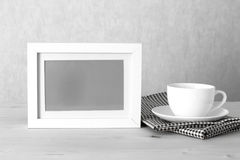 Photo frame and coffee cup Royalty Free Stock Images