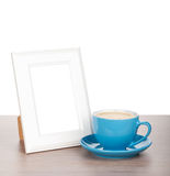 Photo frame and coffee cup Royalty Free Stock Photo