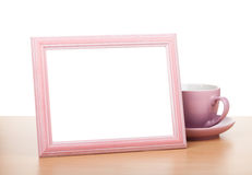 Photo frame and coffee cup Royalty Free Stock Photography