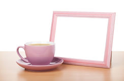 Photo frame and coffee cup Royalty Free Stock Photos