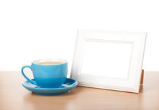 Photo frame and coffee cup Stock Image