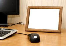 Photo frame on computer table Stock Image