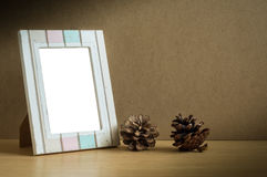 Photo frame with cone pine. Stock Photography