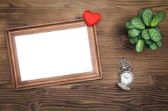 Blank photo frame. Photo frame with copy space and wedding ring in a present box. Declaration of love. Offer to get married. Miss of girl friend stock images