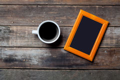 Photo frame and cup of coffee Royalty Free Stock Photography
