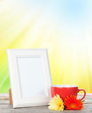 Photo frame with cup of coffee and gerbera flowers Royalty Free Stock Photo