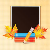 Photo frame decorated with autumn maple leaves and school Royalty Free Stock Image