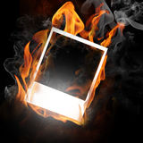 Photo frame in flame. Isolated on black Stock Images