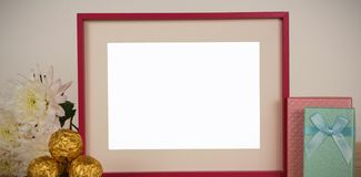 Photo frame, flower, chocolates and gift boxes on a table. Empty photo frame, flower, chocolates and gift boxes on a table royalty free stock photography