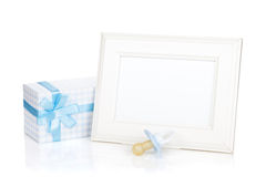 Photo frame with gift box and boy dummy Stock Photo