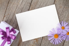 Photo frame with gift box and gerbera flowers Stock Photos