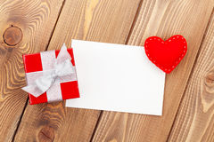 Photo frame or greeting card with gift box and toy heart Stock Photography