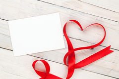 Photo frame or greeting card and valentines heart shaped ribbon Royalty Free Stock Images