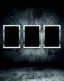 Photo frame on grunge wall Stock Image