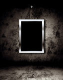 Photo frame on grunge wall Stock Photos
