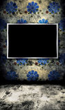 Photo frame on grunge wall Royalty Free Stock Photos