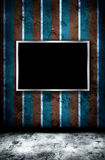 Photo frame on grunge wall Royalty Free Stock Images