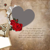 Photo frame heart-shaped, rose, old documents on a vintage background Stock Photos
