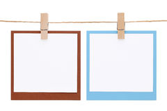 Photo frame hung on rope with clothespin. Isolated on white background Royalty Free Stock Image