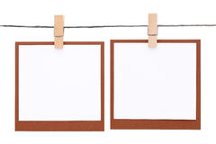 Photo frame hung on rope with clothespin Royalty Free Stock Photo