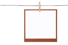 Photo frame hung on rope with clothespin Royalty Free Stock Photography