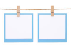 Photo frame hung on rope. With clothespin isolated on white background Royalty Free Stock Image