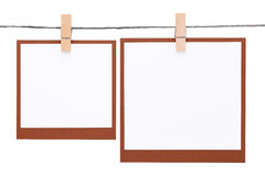 Photo frame hung on rope with clothespin Royalty Free Stock Image
