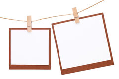 Photo frame hung on rope with clothespin Stock Photo