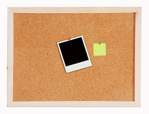 Photo frame isolated on Cork board Royalty Free Stock Image