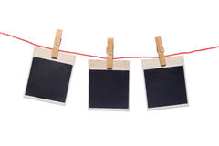 Photo frame isolated on white. Photo-frameworks hang on a cord on a white background Stock Image