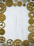 Photo frame, from a large number of watch gears on a wh. Photo frame assembled from a large number of watch gears on a white background stock images