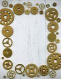 Photo frame, from a large number of watch gears on a wh. Photo frame assembled from a large number of watch gears on a white background royalty free stock images
