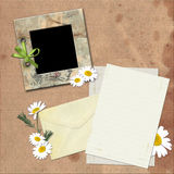 Photo frame and a letter. Stock Photography