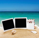 Photo frame and a letter from vacation in the sand Royalty Free Stock Image