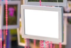 photo frame made of white wood hanging on branch Royalty Free Stock Photography