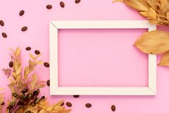 Photo frame mock up with space for text, golden confetti on white background. Lay Flat, top view. Valentine`s minimal background royalty free stock image