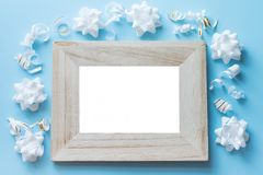 Photo frame mock up with space for text, white confetti on blue background. Lay Flat, top view. birthday background stock photo