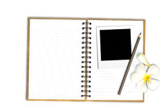 Photo frame on note book with flower Stock Photography