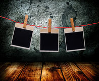 The photo of a frame in an nterior. The photo of a frame hang on clothespins in an old interior Royalty Free Stock Photography