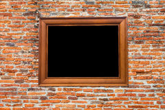 Photo Frame on Old brick wall Stock Photo