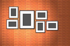 Photo frame on old brick wall Royalty Free Stock Photo