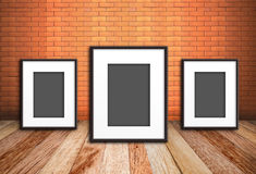 Photo frame on old brick wall royalty free stock images