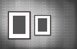 Photo frame on old brick wall Stock Photos