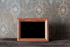Photo-frame on old table Stock Photo