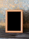 Photo-frame on old table Royalty Free Stock Photo