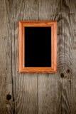 Photo frame on old wood Stock Image