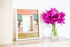 Photo frame. Old wooden photo frame with orchid flower in vase decoration interior of room Royalty Free Stock Photography