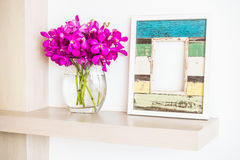 Photo frame. Old wooden photo frame with orchid flower in vase decoration interior of room Stock Photography
